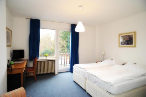 Кровать или кровати в номере Hotel Waldesruh