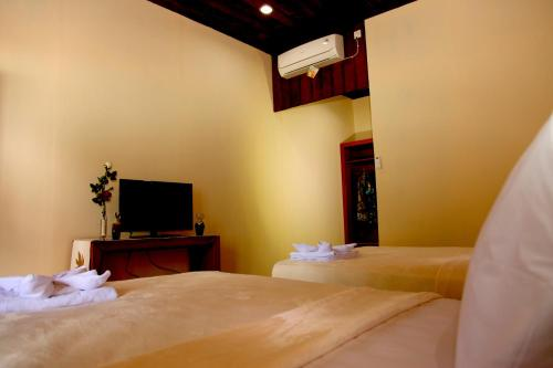 A bed or beds in a room at Pratasaba Resort