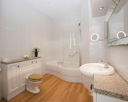 A bathroom at The George Hotel, Sure Hotel Collection by Best Western