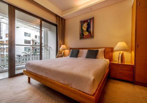Ein Bett oder Betten in einem Zimmer der Unterkunft CM+ Service Apartment Shenzhen Taige