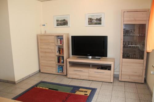 Ferienwohnungen im Gästehaus Sieberns TV 또는 엔터테인먼트 센터