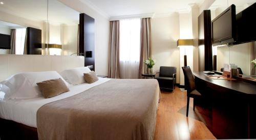Cama o camas de una habitación en Hotel Saray