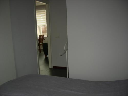 Een bed of bedden in een kamer bij B&B Kei Moj