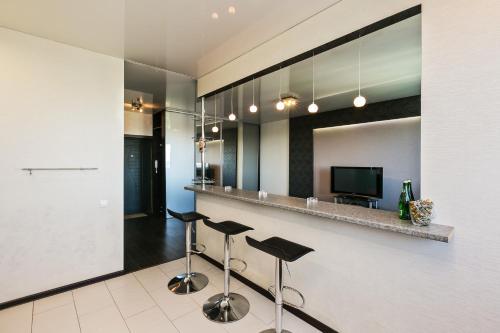 Телевизор и/или развлекательный центр в Апартаменты Fon Haus на Рощинской