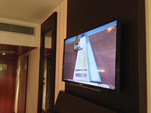 A television and/or entertainment center at Hotel Europa
