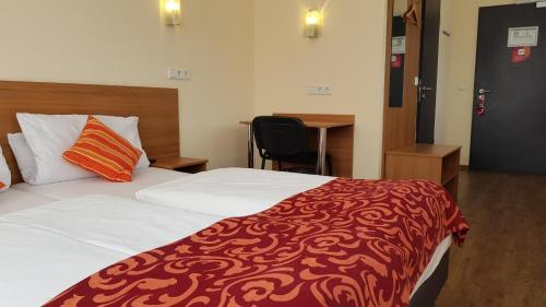 Кровать или кровати в номере Dream Inn Hotel Regensburg Ost