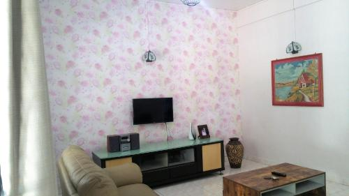 A television and/or entertainment center at GuestHouse Taman Megah, Lot 19