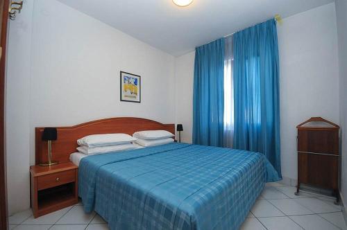 Кровать или кровати в номере Hotel Aquamarin