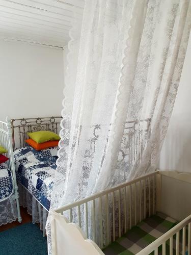 Кровать или кровати в номере Дом для отдыха на улице Казачья