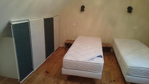 A bed or beds in a room at Maison de village/Appartement de charme avec extérieur