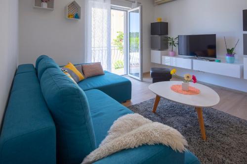 A seating area at Apartman Pjero 3+2