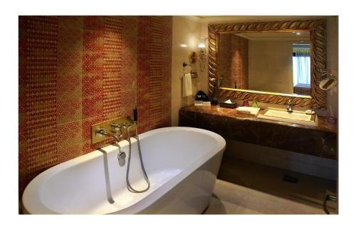 "A bathroom at Fragrant Nature Kochi - ""A Classified Five Star Hotel"""