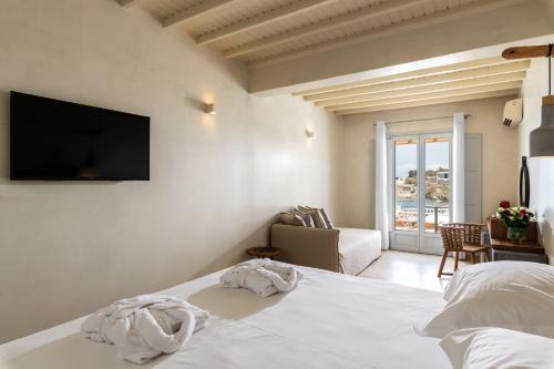 A bed or beds in a room at Poseidon Hotel Suites