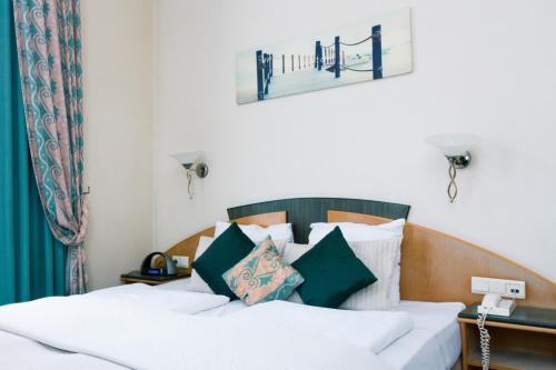 Een bed of bedden in een kamer bij Hotel Moby Dick by WP hotels