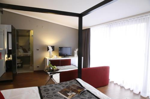 TV/Unterhaltungsangebot in der Unterkunft Hotel Samm Bistro Spa