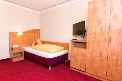 Ein Bett oder Betten in einem Zimmer der Unterkunft Hotel Cortina