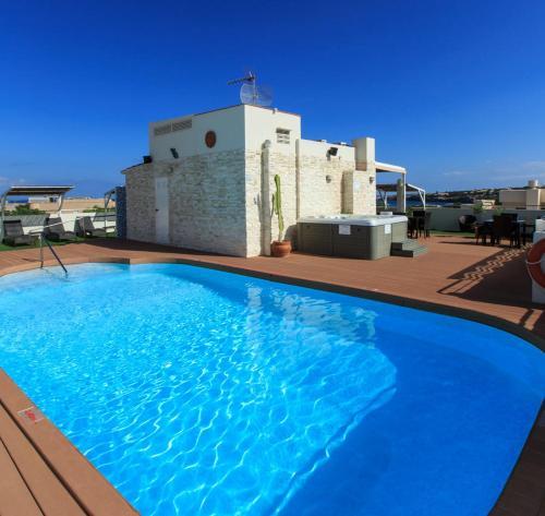 The swimming pool at or near Hotel Sa Volta