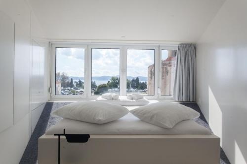 A bed or beds in a room at Boutique Hostel Forum
