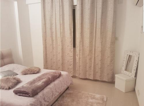 A bed or beds in a room at Appartement Alger urba new