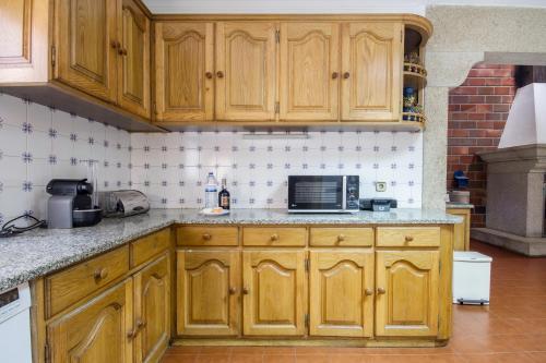 A kitchen or kitchenette at Gião - Porto Green&Pool Villa