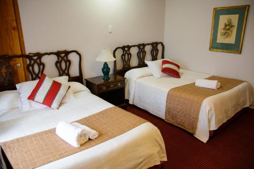 A bed or beds in a room at Hotel Boston Quillota