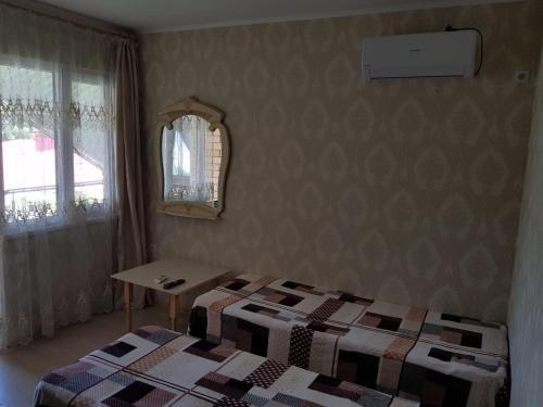 Кровать или кровати в номере Гостевой дом Юлианна