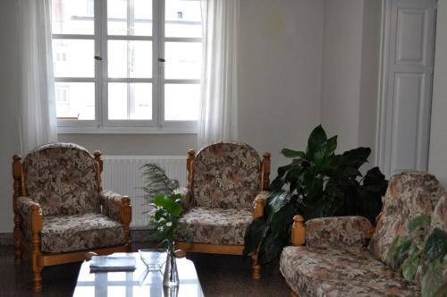 Un lugar para sentarse en Albergue Pensión Cantábrico Fonsagrada