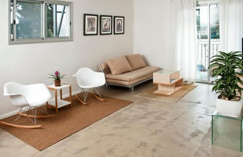 A seating area at G38 Rental Apartment Building