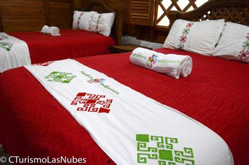 A bed or beds in a room at Ecolodge Las Nubes Chiapas