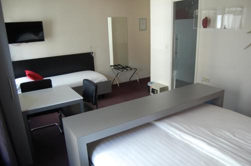Een bed of bedden in een kamer bij Vesting10