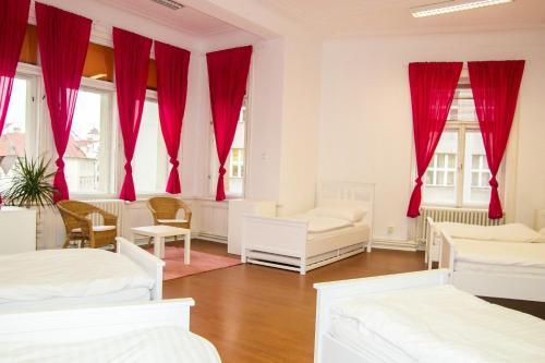 Een bed of bedden in een kamer bij Hostel Franz Kafka
