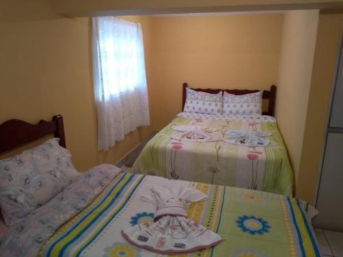 Cama ou camas em um quarto em Suítes do Valle