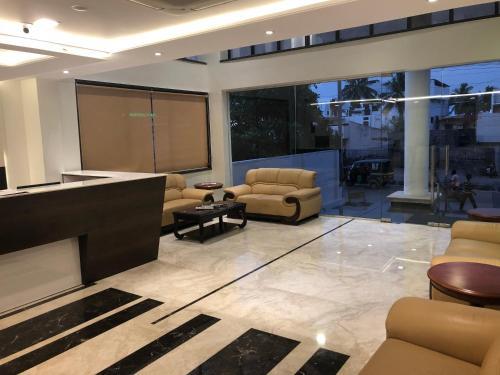 The lobby or reception area at Kyriad Hotel Vijayapura by OTHPL
