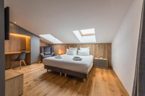 Un ou plusieurs lits dans un hébergement de l'établissement Emerald Stay Apartments Morzine - by EMERALD STAY
