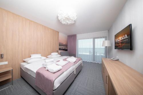 Łóżko lub łóżka w pokoju w obiekcie Baltivia Sea Resort