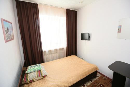 Кровать или кровати в номере Красноярский пр-д одноместный эконом