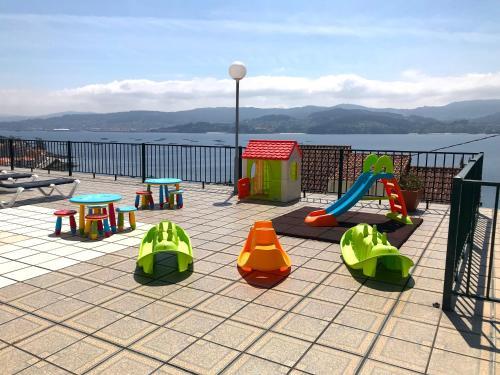 Zona de juegos infantil en Apartamentos Park Raxo