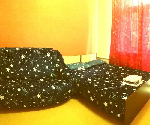 Кровать или кровати в номере Серышева 34