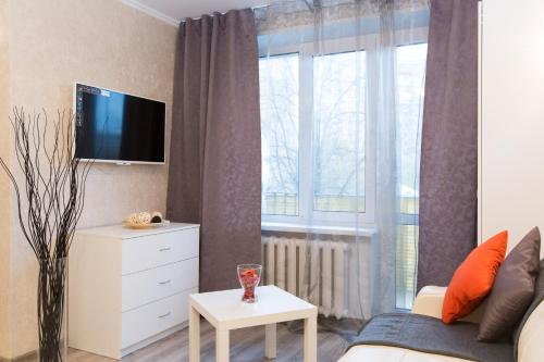 A television and/or entertainment center at Lux Apartments - Krasnoselskaya