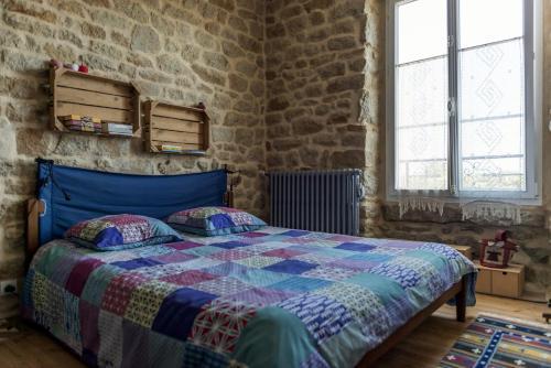 Un ou plusieurs lits dans un hébergement de l'établissement Comme à la Breizhon