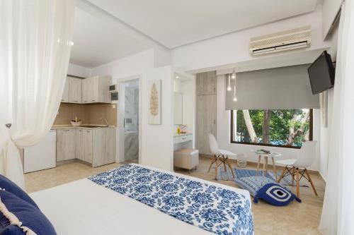 A bed or beds in a room at Lyristis Studios & Apartments