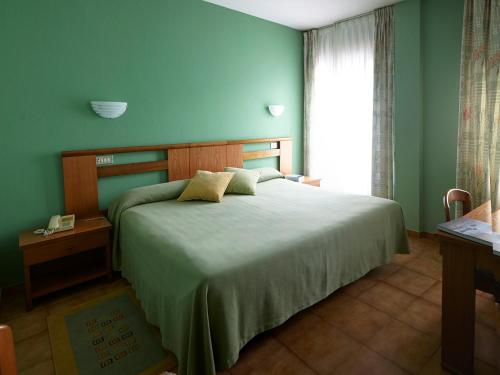 Cama o camas de una habitación en Hotel Rico