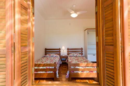 Cama ou camas em um quarto em Fazenda Santa Teresa Hotel