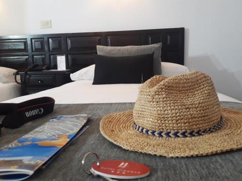 Un ou plusieurs lits dans un hébergement de l'établissement Hotel Miramar