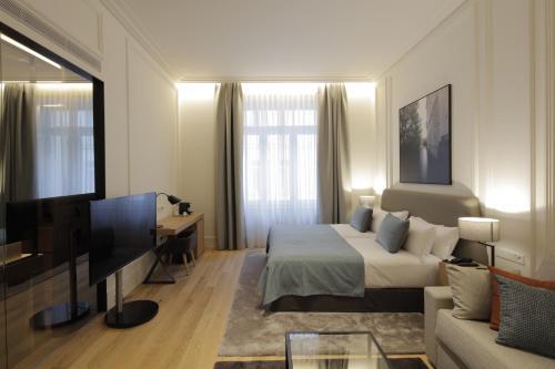Télévision ou salle de divertissement dans l'établissement BoHo Prague Hotel - Small Luxury Hotels