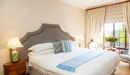 A bed or beds in a room at Ivory Manor Boutique Hotel