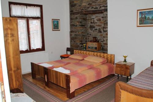A bed or beds in a room at **ETNO Vila** - KRUSEVO