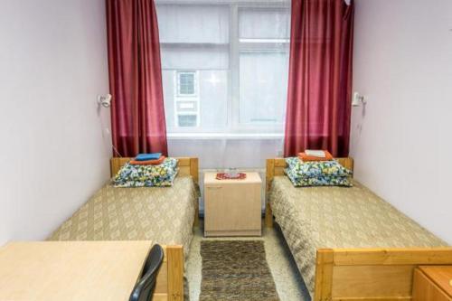 Voodi või voodid majutusasutuse Guesthouse Rehab toas