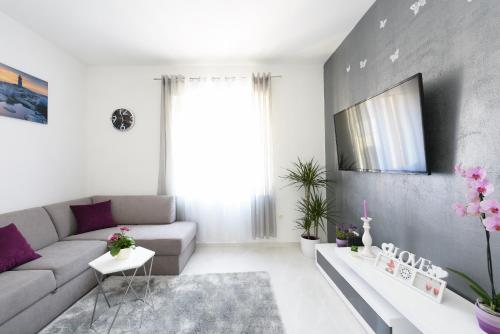 A seating area at Apartment Lant