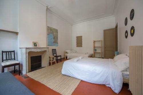 A bed or beds in a room at NOCNOC - Le Liberté